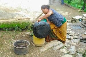 Pabitra making raksi