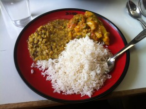 A typical Nepali meal of rice, vegetables and dhal.